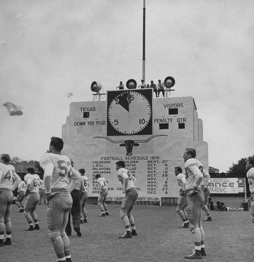 Circa 1940s - Members of the Univ. of Texas football team warming up with exercises before a game.  (Photo by George Strock//Time Life Pictures/Getty Images) Photo: George Strock, Time & Life Pictures/Getty Image / Time Life Pictures