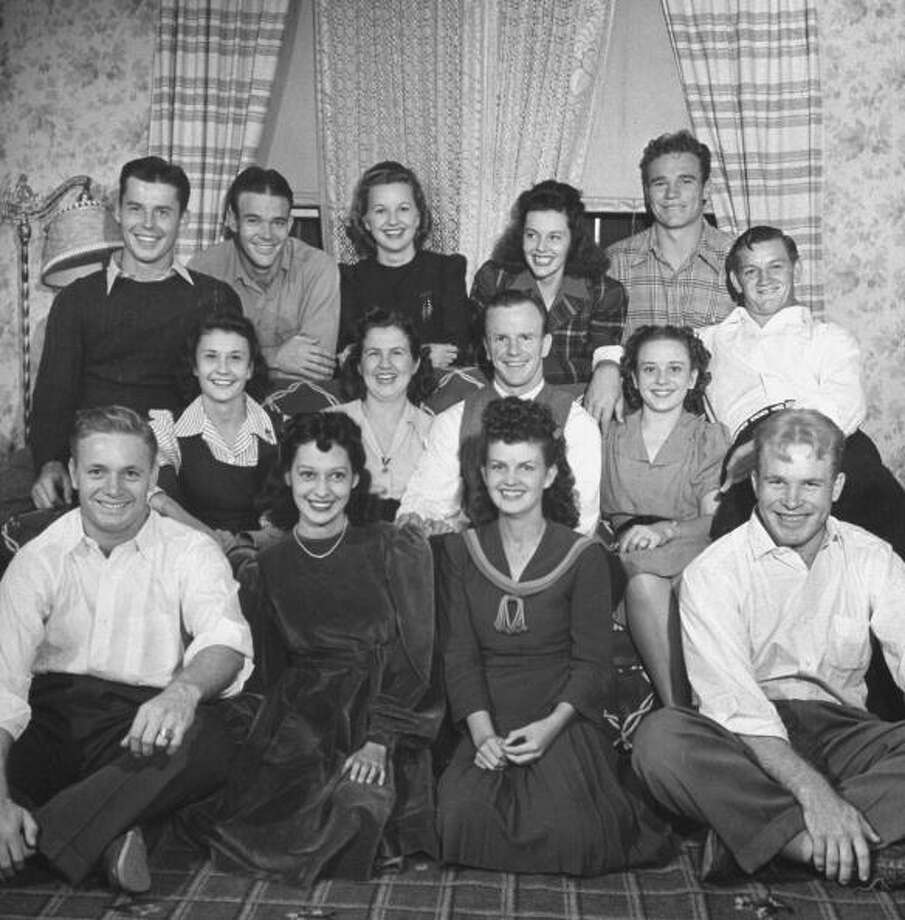 Circa 1940s - Married members of the Univ. of Texas football team posing with their wives, circa 1940s.  (Photo by George Strock//Time Life Pictures/Getty Images) Photo: George Strock, Time & Life Pictures/Getty Image / Time Life Pictures