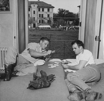 Circa 1940s - Univ. of Texas football players Harold Jungmichel (L) and Donald Cohenour playing a game of rummy before a game.  (Photo by George Strock//Time Life Pictures/Getty Images) Photo: George Strock, Time & Life Pictures/Getty Image / Time Life Pictures