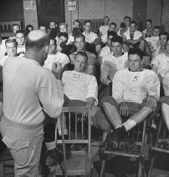 Circa 1940s - Univ. of Texas football coach Dana Bible (L) talking to his team.  (Photo by George Strock//Time Life Pictures/Getty Images) Photo: George Strock, Time & Life Pictures/Getty Image / Time Life Pictures