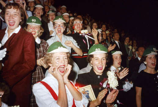 View of mostly female fans in the bleachers at the homecoming football game at MacMurray College, Abilene, Texas, September 21, 1946. Many of the young women wear green & red face paint and green caps featuring the number 60 and handwritten slogans. (Photo by J. R. Eyerman/Time & Life Pictures/Getty Images) Photo: J. R. Eyerman, Time & Life Pictures/Getty Image / Time & Life Pictures