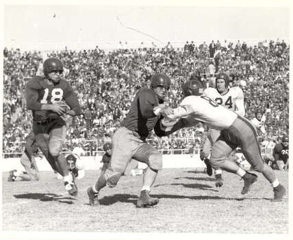 Players from the Penn State University Nittany Lions (in white) play the Southern Methodist University Mustangs during the 1948 Cotton Bowl at Cotton Bowl Stadium in Dallas, Texas.  Penn State tied SMU 13-13. (Photo by Cotton Bowl/Collegiate Images/Getty Images) Photo: Collegiate Images, Collegiate Images/Getty Images / 2009 Cotton Bowl