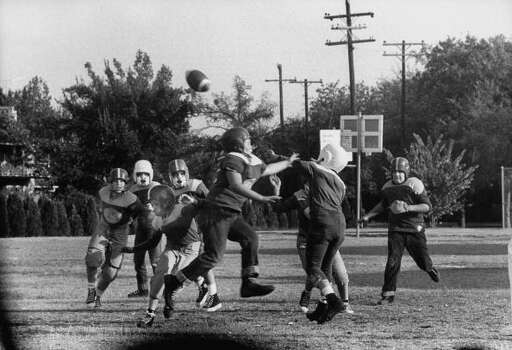 Circa 1950s - Quarterback passing the ball during the Paint Creek High School vs Benjamin High six-man football game.  (Photo by Joseph Scherschel//Time Life Pictures/Getty Images) Photo: Joseph Scherschel, Time & Life Pictures/Getty Image / Time Life Pictures