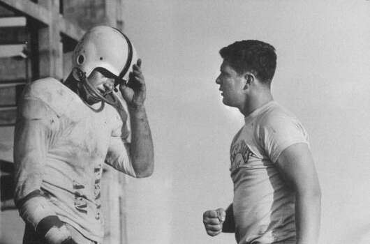 Circa 1950s - Coach Dennis Goehring (R) talking with player Robert Garner (L) during a pre-season practice of the Texas A & M football team.  (Photo by Joseph Scherschel//Time Life Pictures/Getty Images) Photo: Joseph Scherschel, Time & Life Pictures/Getty Image / Time Life Pictures