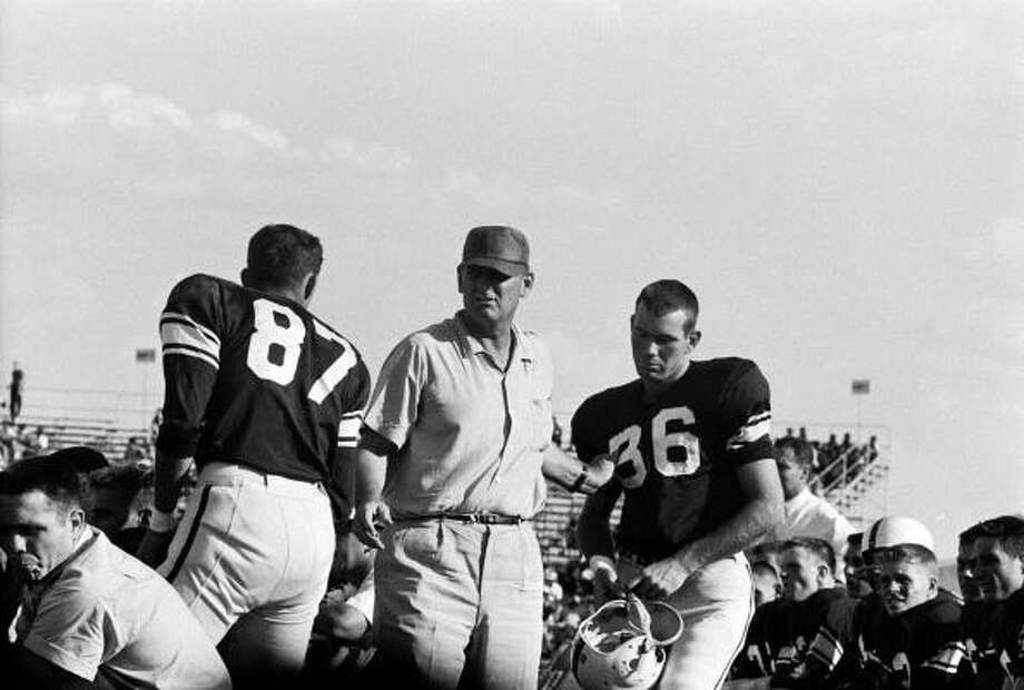 Texas A&M Football Coach Paul Bryant ('Bear Bryant') (1913 - 1983) prepares to send an undentified player (#36) into a game against Villanova at College Station, Texas, September 22, 1956. (Photo by Joe Scherschel/Time & Life Pictures/Getty Images) Photo: Joseph Scherschel., Time & Life Pictures/Getty Image / Time Life Pictures