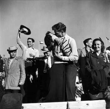 TEXAS, UNITED STATES - NOVEMBER 1950:  Pair of Texas University students kissing after a close football victory over Southern Methodist University, who had been the favored team.  (Photo by Joseph Scherschel/Time & Life Pictures/Getty Images) Photo: Joseph Scherschel, Time & Life Pictures/Getty Image / Time & Life Pictures