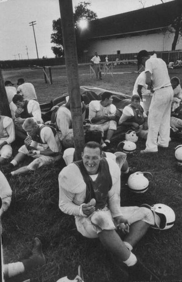 Circa 1950s - Player Roger Hawthorne sitting with his team during a pre-season practice of the Texas A & M football team.  (Photo by Joseph Scherschel//Time Life Pictures/Getty Images) Photo: Joseph Scherschel, Time & Life Pictures/Getty Image / Time Life Pictures