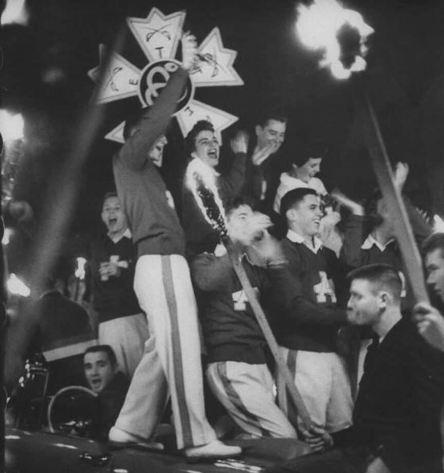 Circa 1950s - Torchlight parade led by cheerleaders in a convertible drawing some 4,000 students to a pep rally the night before Arkansas played Texas A&M.  (Photo by Joseph Scherschel//Time Life Pictures/Getty Images) Photo: Joseph Scherschel, Time & Life Pictures/Getty Image / Time Life Pictures