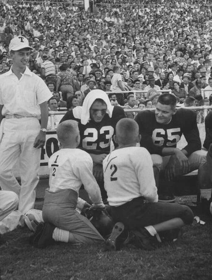 Circa 1950s - Two young football players having a chat with two older during the Texas A&M vs Villanova football game.  (Photo by Joseph Scherschel//Time Life Pictures/Getty Images) Photo: Joseph Scherschel, Time & Life Pictures/Getty Image / Time Life Pictures