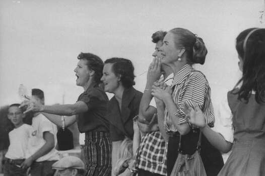Circa 1950s - Young ladies yelling from the stands at the Texas A&M vs Villanova football game.  (Photo by Joseph Scherschel//Time Life Pictures/Getty Images) Photo: Joseph Scherschel, Time & Life Pictures/Getty Image / Time Life Pictures