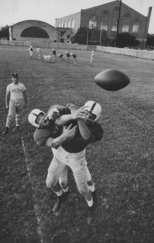 Circa 1950s - Players Don McClelland (L) and Bobby Conrad (2L) during a pre-season practice of the Texas A & M football team.  (Photo by Joseph Scherschel//Time Life Pictures/Getty Images) Photo: Joseph Scherschel, Time & Life Pictures/Getty Image / Time Life Pictures