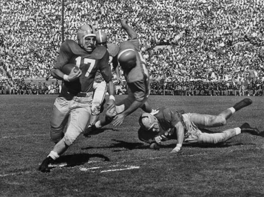 Circa 1950s - Action during a football game between Notre Dame and the University of Texas.  (Photo by Joseph Scherschel//Time Life Pictures/Getty Images) Photo: Joseph Scherschel, Time & Life Pictures/Getty Image / Time Life Pictures