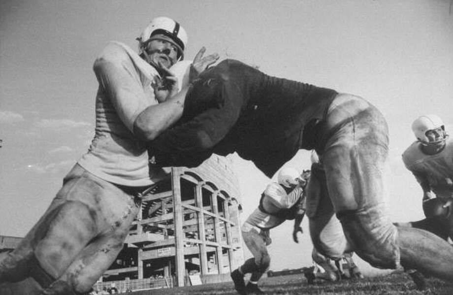 Circa 1950s - Players Charles Sandford (L) and John Tracey (R) during a pre-season practice of the Texas A & M football team.  (Photo by Joseph Scherschel//Time Life Pictures/Getty Images) Photo: Joseph Scherschel, Time & Life Pictures/Getty Image / Time Life Pictures