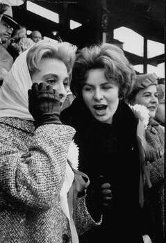 Syracuse Univ. football players wives Mrs. Ger Schwedes (L) and Mrs. Bob Yates watching their husbands play Texas during the 1960 Cotton Bowl game.  (Photo by Donald Uhrbrock//Time Life Pictures/Getty Images) Photo: Donald Uhrbrock, Time & Life Pictures/Getty Image / Donald Uhrbrock