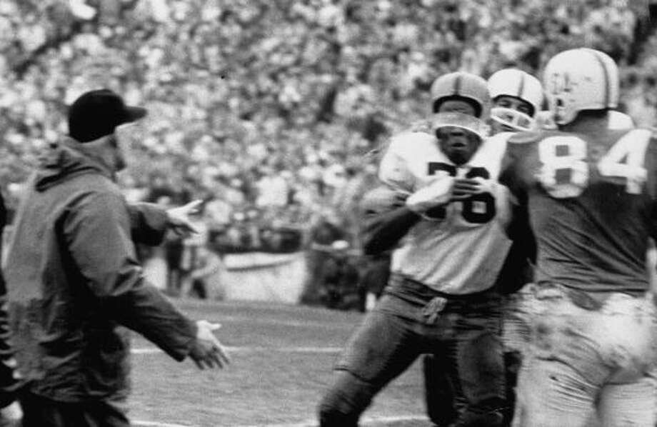 Syracuse coach Floyd B. Schwartzwalder (L) rushing out to stop football player John Brown (C) in fight over racial insult from Texas player during the 1960 Cotton Bowl game.  (Photo by Robert W. Kelley//Time Life Pictures/Getty Images) Photo: Robert W. Kelley, Time & Life Pictures/Getty Image / Time Life Pictures
