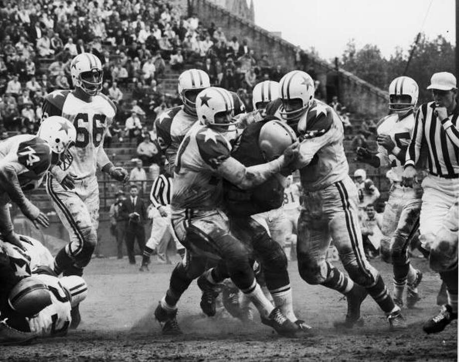 The Dallas Cowboys tackle an unidentified opponent, early 1960s. (Photo by Robert Riger/Getty Images) Photo: Robert Riger, Getty Images / 2006 Getty Images