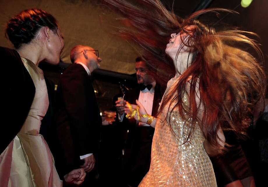 Megan Kurashige and Lauren Ghallager (left to right) dance to Michael Jackson during the after-party of the 102nd San Francisco Symphony Gala in San Francisco Calif. on Tuesday, Sept. 3, 2013. It was their first time attending the event. Photo: Alex Washburn, Special To The Chronicle