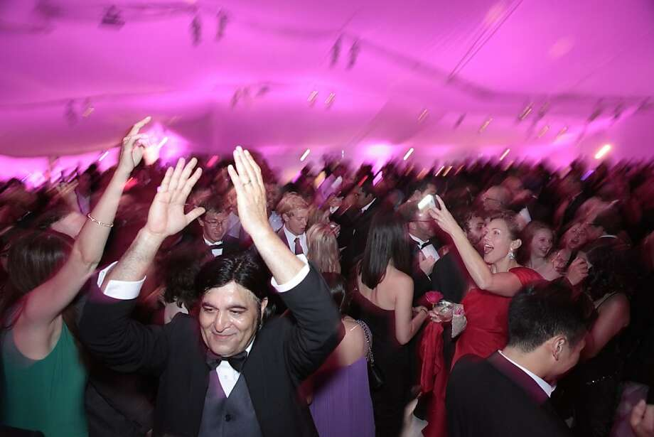 Mirza Alam claps his hands in the air to the music during the after-party of the 102nd San Francisco Symphony Gala in San Francisco Calif. on Tuesday, Sept. 3, 2013.  The after-party started just after the musical performances and lasted till midnight. Photo: Alex Washburn, Special To The Chronicle