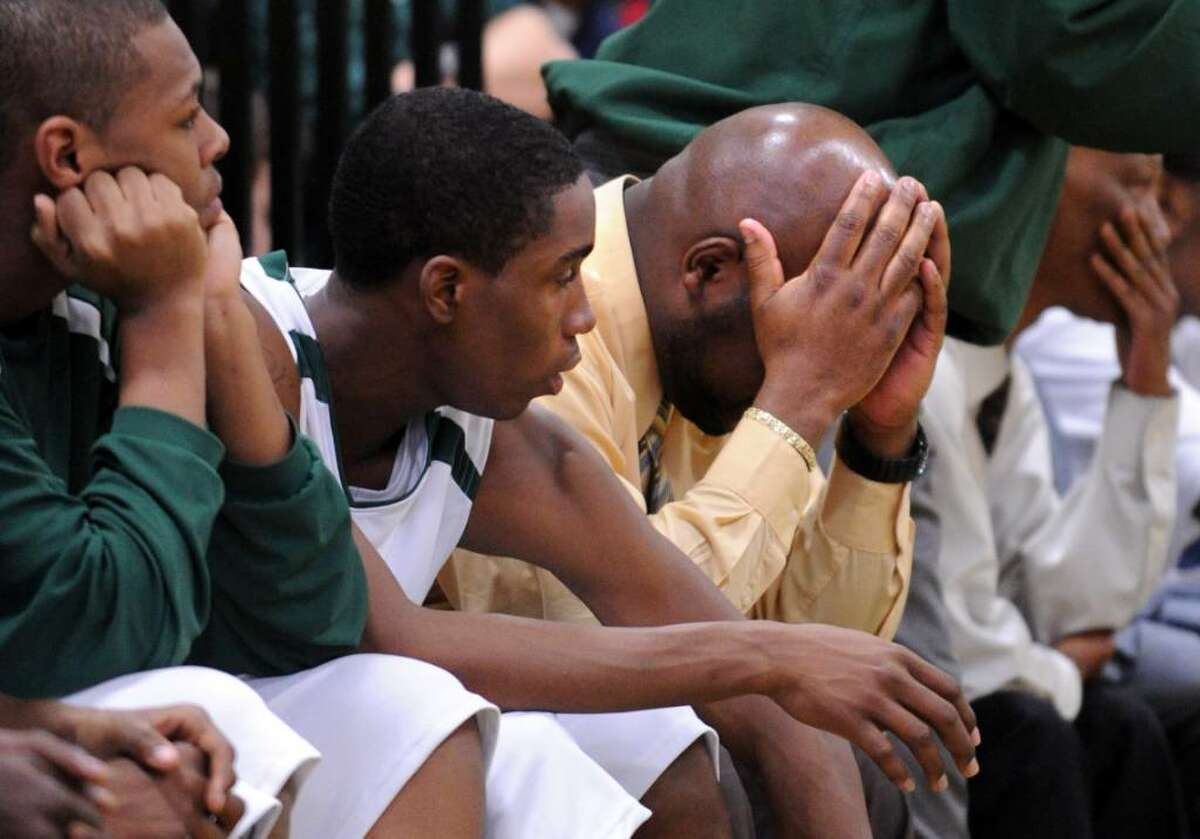 Bassick players and coaches react during Friday night's game against Central.