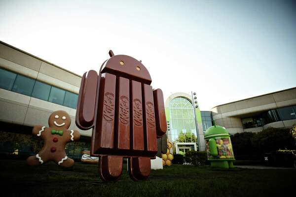This undated product image provided by Google Inc. shows the new Kit Kat bar Android statue outside Google Inc. headquarters in Mountain View, CA. Google is naming its new Android operating system after the chocolate bar. The Android 4.4 KitKat system is expected to launch in October 2013. (AP Photo/The Hershey Company).