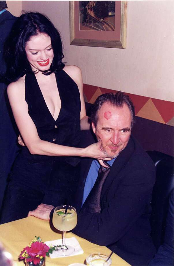 "1996: McGowan and director Wes Craven during ""Scream"" premiere in Los Angeles. Photo: Jeff Kravitz, / / FilmMagic, Inc"