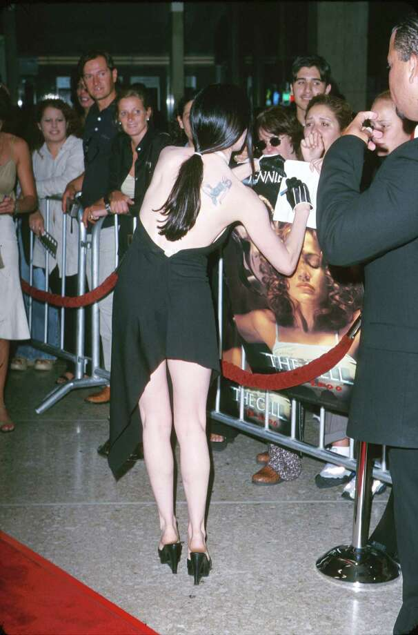 2000: McGowan signs autographs from the red carpet at an unspecified event. Photo: S. Granitz, / / WireImage