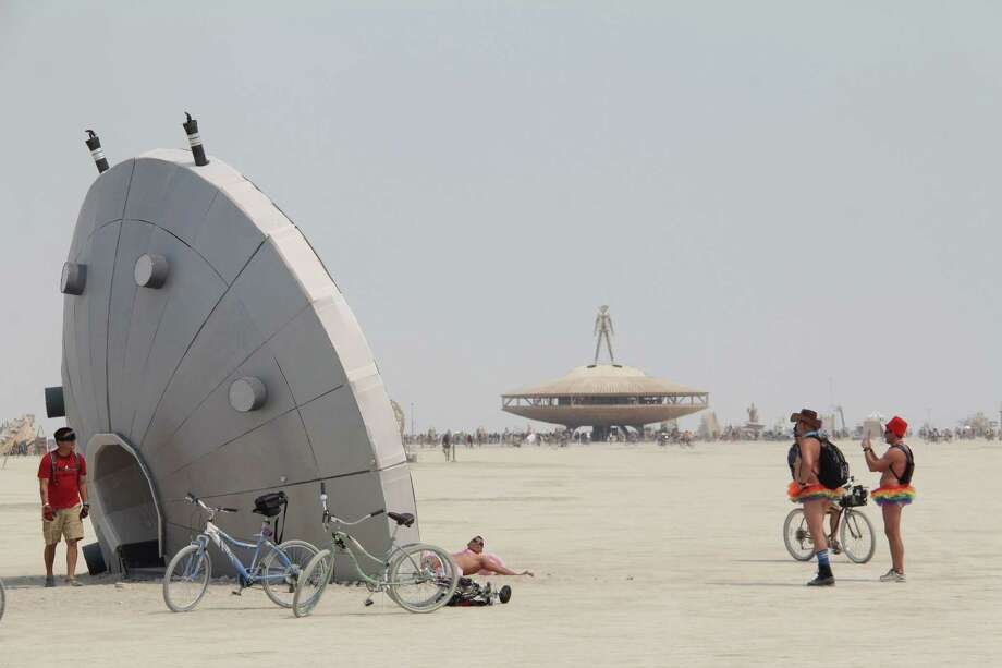 A crashed spacecraft attracts attention at Burning Man 2013. http://www.fest300.com/ Photo: Art Gimbel / Fest300.com