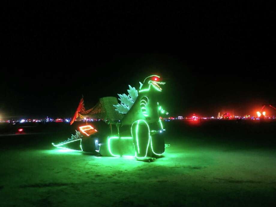 Godzilla glows green on the the Playa at Burning Man 2013. http://www.fest300.com/ Photo: Art Gimbel / Fest300.com