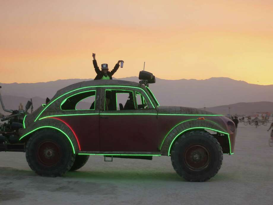 An art car rumbles by at sunset at Burning Man 2013. http://www.fest300.com/ Photo: Art Gimbel / Fest300.com