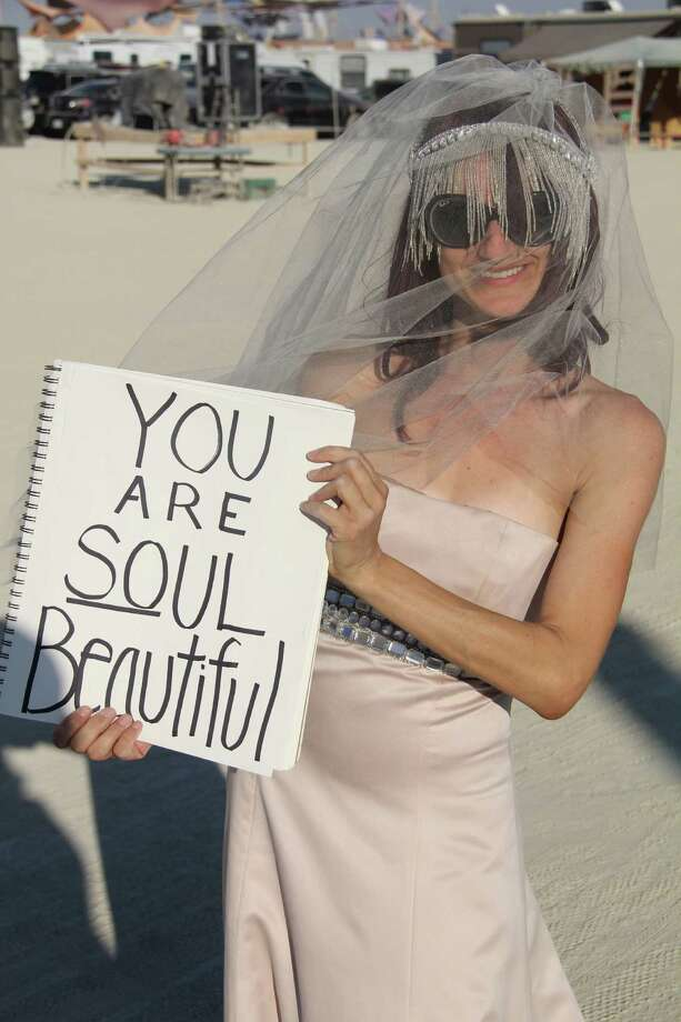 A woman shares an inspirational message at Burning Man 2013. http://www.fest300.com/ Photo: Art Gimbel / Fest300.com