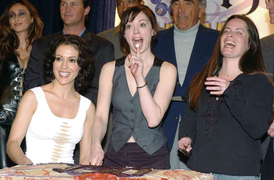 "2005: Alyssa Milano, McGowan and Holly Marie Combs celebrate the 150th episode of ""Charmed."" Photo: L. Cohen, / / WireImage"
