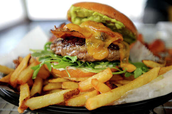 The Sonoma Burger at Burger Guys consists of avocado, cheddar, bacon and aidi arugula.