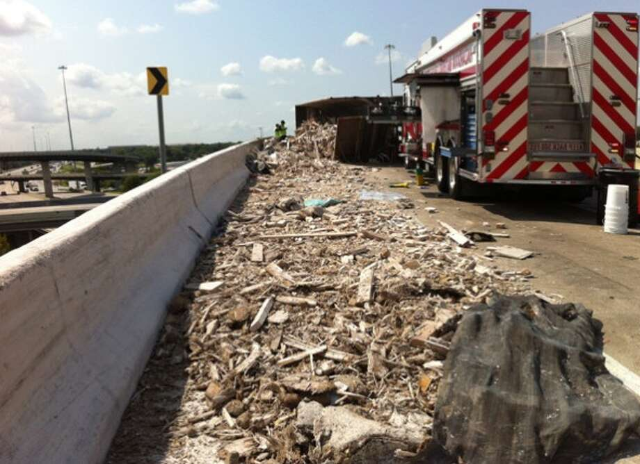 An 18-wheeler has lost a load of construction material on the North loop. (TxDOT)