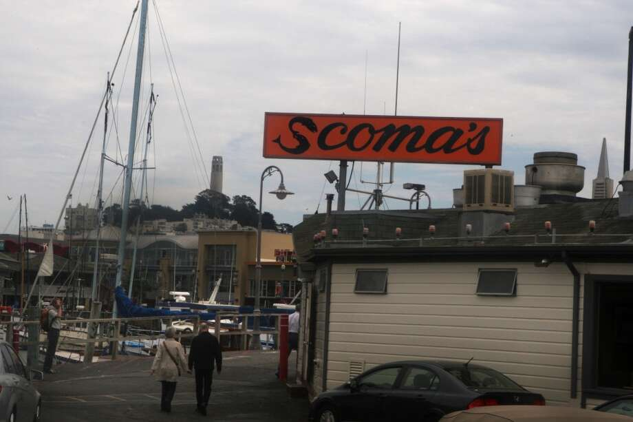 Pedestrians walk past Scoma's. Photo: Liz Hafalia, The Chronicle