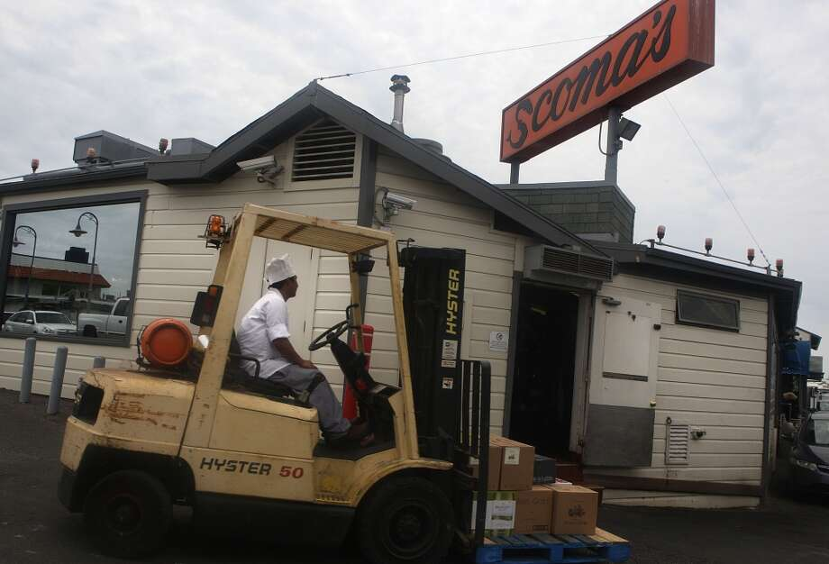 A shipment of wine is delivered to Scoma's. Photo: Liz Hafalia, The Chronicle