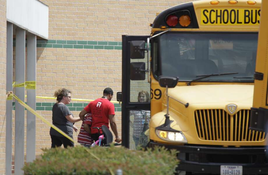Students are being loaded onto buses outside Spring High School where a student was fatally stabbed and three others injured Wednesday, Sept. 3, 2013. (Melissa Phillip/ Houston Chronicle) Photo: Melissa Phillip, Chronicle