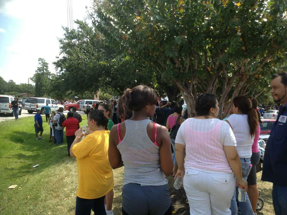 People wait for students outside Spring High School, where one person was fatally stabbed and three more were injured on Wed., Sept. 4. (Photo courtesy KIAH 39)