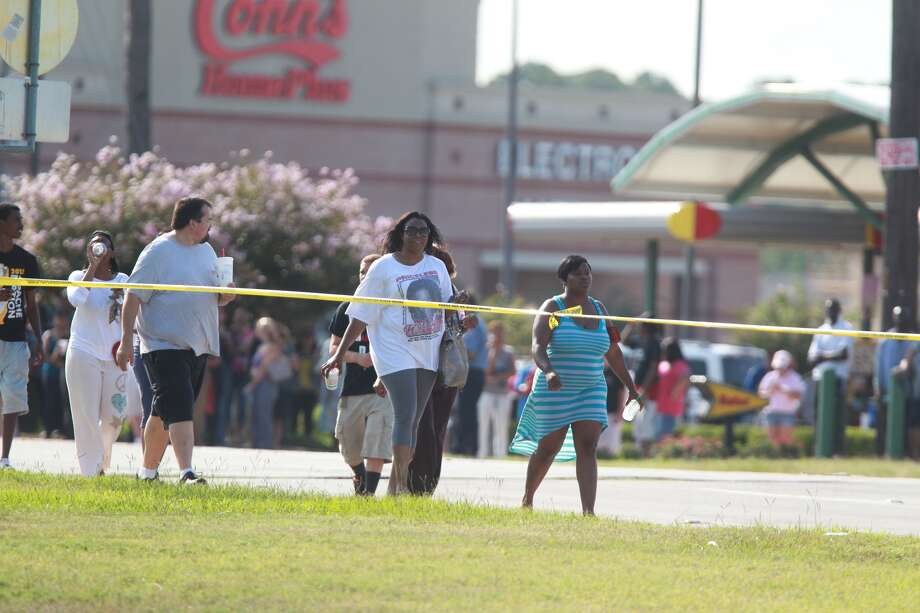 People wait outside Spring High School Wednesday as police investigate a fatal stabbing at the school. Photo: Mayra Beltran, Chronicle