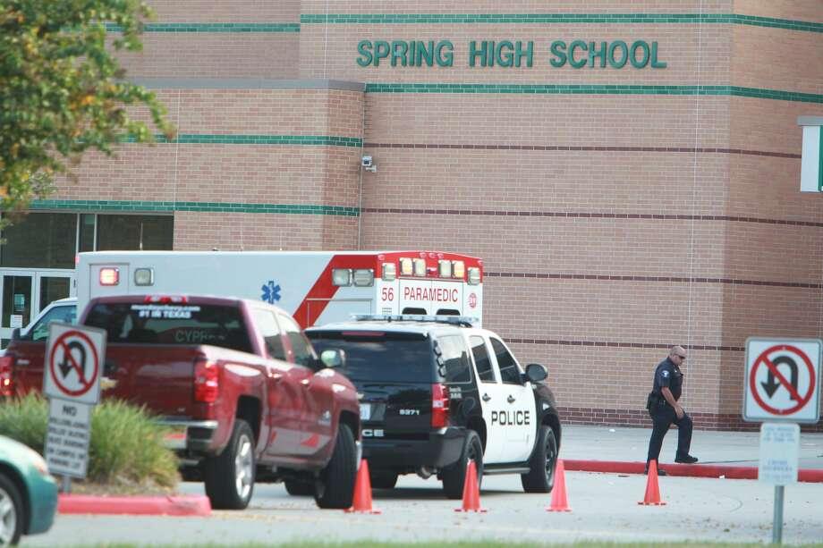Police investigate a fatal stabbing at Spring High School on Wednesday, Sept. 4, 2013. (Mayra Beltran/Houston Chronicle) Photo: Mayra Beltran, Houston Chronicle