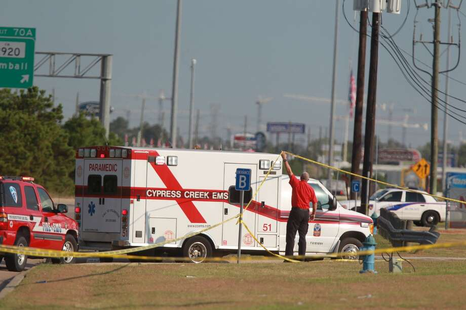 An ambulance crosses crime scene tape at Spring High School, where police are investigating a fatal stabbing on Wed., Sept. 4 Photo: Mayra Beltran, Chronicle