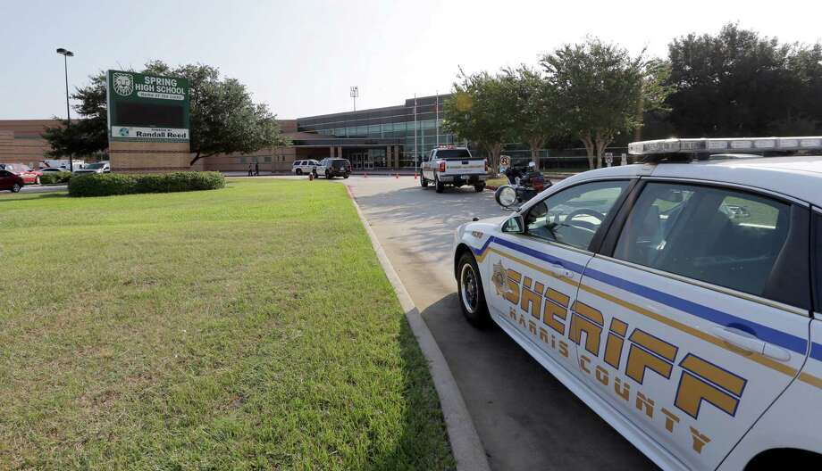 Emergency vehicles park outside Spring High School Wednesday, Sept. 4, 2013, in Spring, Texas. A 16-year-old boy has been airlifted from the school in suburban Houston with stab wounds suffered in an altercation at the campus. The Harris County Sheriff's Office says it responded about 7 a.m. Wednesday to Spring High School to a report of a stabbing. Spring is about 20 miles north of Houston. Photo: AP