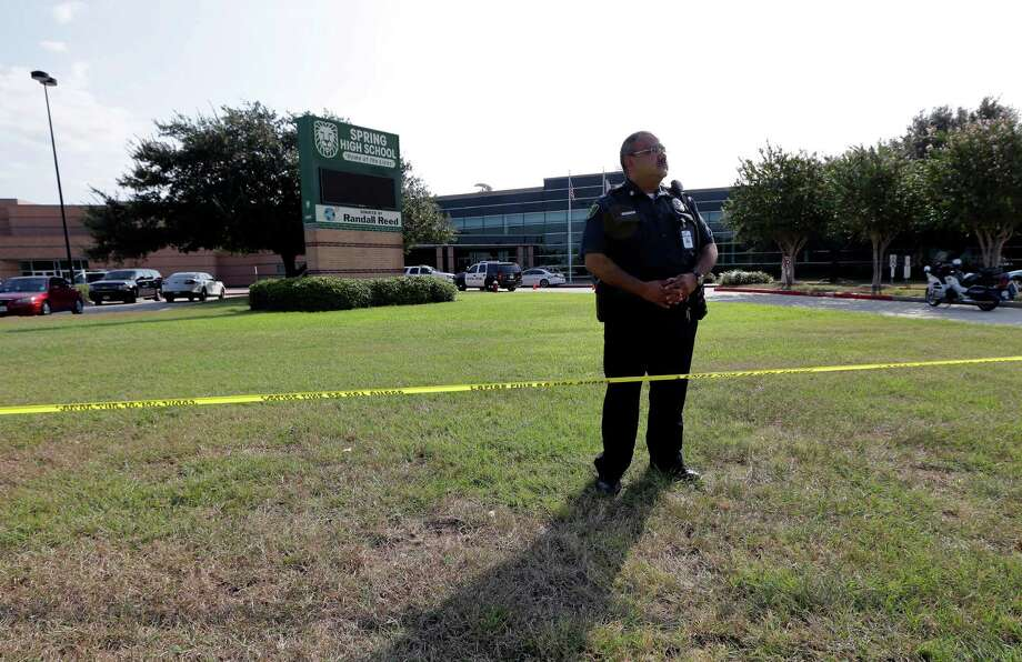 A Harris County Sheriff's Deputy stands outside Spring High School Wednesday, Sept. 4, 2013, in Spring, Texas.  At least one person has been killed and others injured in an altercation at the high school in suburban Houston. The Harris County Sheriff's Office did not say whether the people involved in the fight about 7 a.m. Wednesday at Spring High School were all students. Photo: AP
