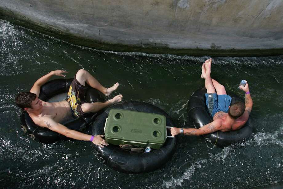Tubers float through a chute on the Comal River in New Braunfels Sunday July 30, 2006. New Braunfels police are cracking down on noise, volume drinking devices and Jell-O shots on the Comal River, the shorter of the two tubing rivers that run through this city about 30 miles northeast of San Antonio. The City Council has upped to $500 the maximum fine for violating a noise ordinance that says music from stereos shouldn't be heard more than 50 feet away. It also banned beer bongs and is considering more bans on evening noise and Jell-O shots.  About 70 percent of the city's annual tourism revenue comes during the summer months, most from water recreation.  Sharon Steinmann/ Houston Chronicle Photo: Sharon Steinmann, Staff / Houston Chronicle