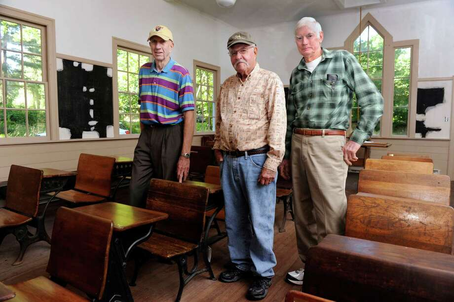 From left, Don Taylor, 80, Leroy Staib, 83 and Ed Rockwell, life-long Bethel, Conn. residents, are photographed in their old school. Plumtrees School, a one-room schoolhouse in Bethel, Conn., continues to be restored, Wednesday, Sept. 4, 2013. Photo: Carol Kaliff / The News-Times