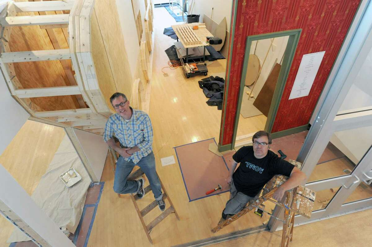 Artists Ken Ragsdale, left, and Michael Oatman are installing a new exhibiton, An Armory Show, at the Opalka Gallery on Tuesday Aug. 20, 2013 in Albany, N.Y. The show opens on August 26 and runs through December 15, 2013.(Michael P. Farrell/Times Union)
