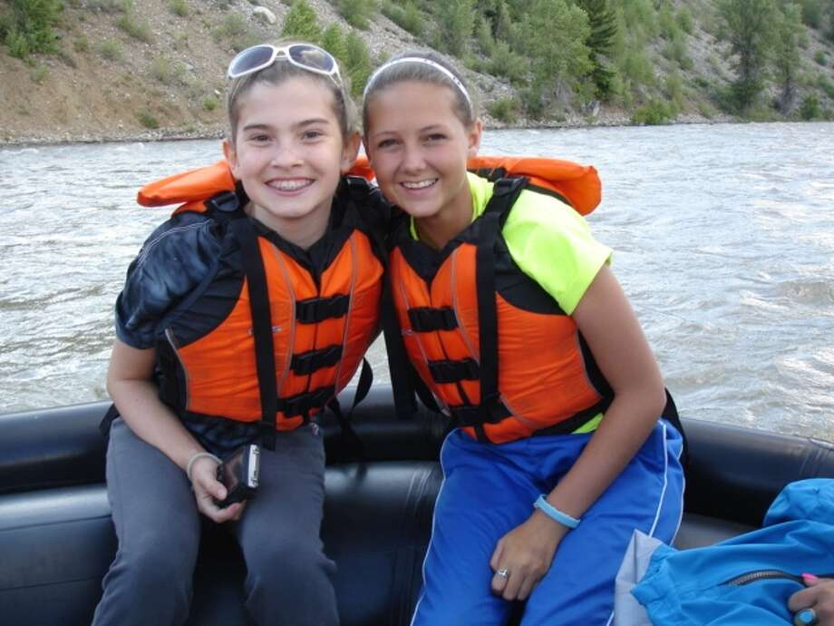 Cancer survivors Presley Ann Boydstun, right, and her friend Sydney enjoyed rafting and other outdoor activities at the Children's Grand Adventure recently in Jackson Hole, Wyo. Photo: Contributed