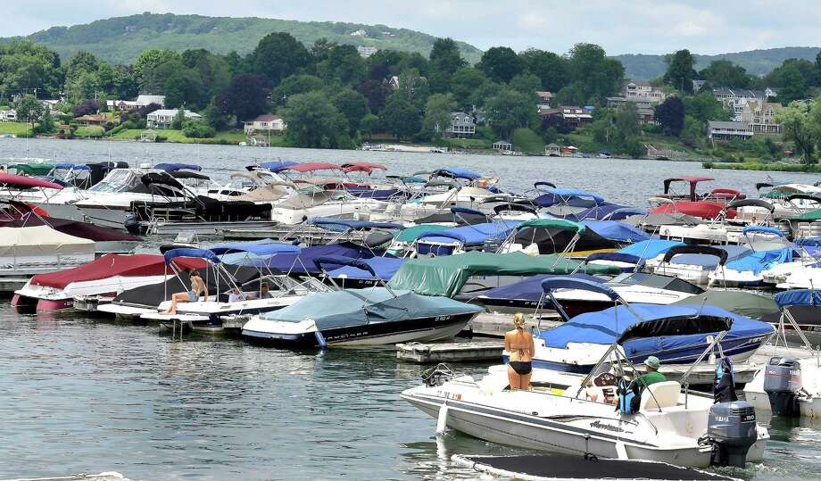 Boats tied up at Echo Bay Marina in Brookfield. The state Department of Energy and Environmental Protection announced Wednesday at beginning Saturday, it will enforce state laws that ban boats 26 feet long or longer on Candlewood Lake. Photo: Michael Duffy / The News-Times