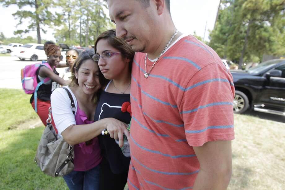 Students leave from Spring High School where a student was fatally stabbed and three others injured Wednesday, Sept. 3, 2013. Photo: Melissa Phillip, Chronicle