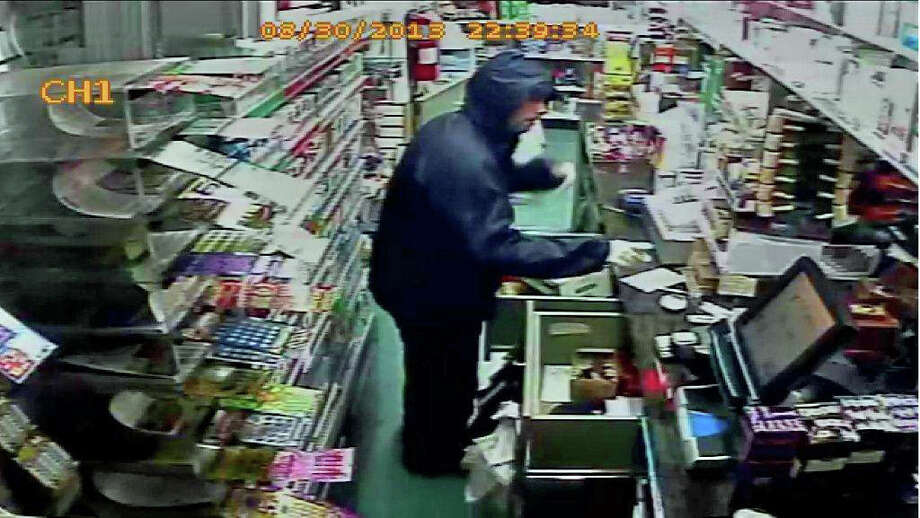 One of two suspects wanted in connection with an armed robbery at a West Main Street convenience store late Friday night. Police are asking for the public's help in identifying the men. Photo: Contributed Photo
