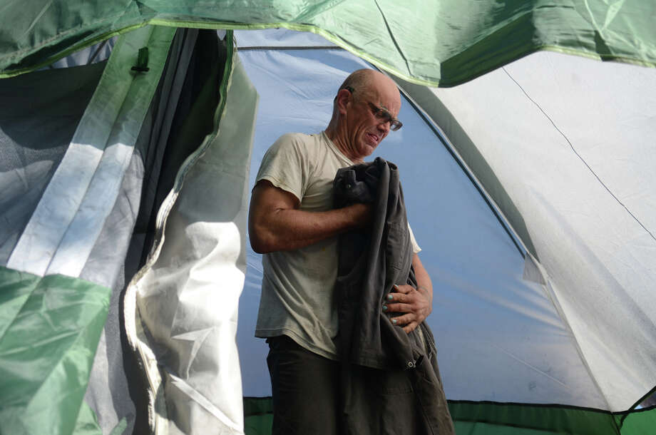 Michael Holmes sorts through his belongings as he packs up during the eviction of residents from the Nickelsville homeless camp on Sunday, Sept. 1, 2013 in West Seattle. Holmes has been living at the site for 6 months, and is uncertain of where he will move next. Photo: SY BEAN, SEATTLEPI.COM / SEATTLEPI.COM